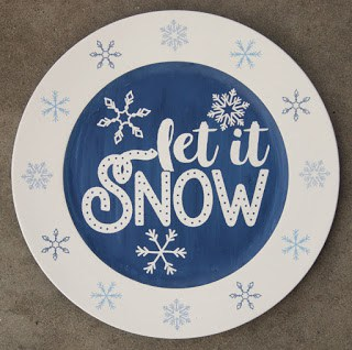 Make this cute painted charger with our free Let It Snow SVG file. These free svg files work with Silhouette and Cricut cutters