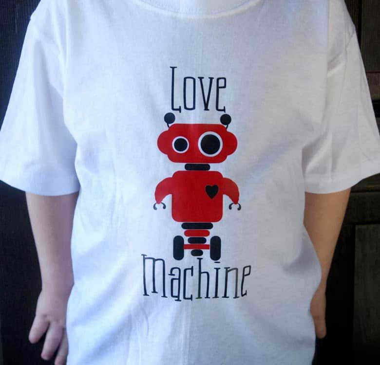 Make a super cute Valentine t-shirt for your little guy with this free Love Machine SVG file. This free Valentine SVG file will work with Silhouette, Cricut, and other electronic cutters.