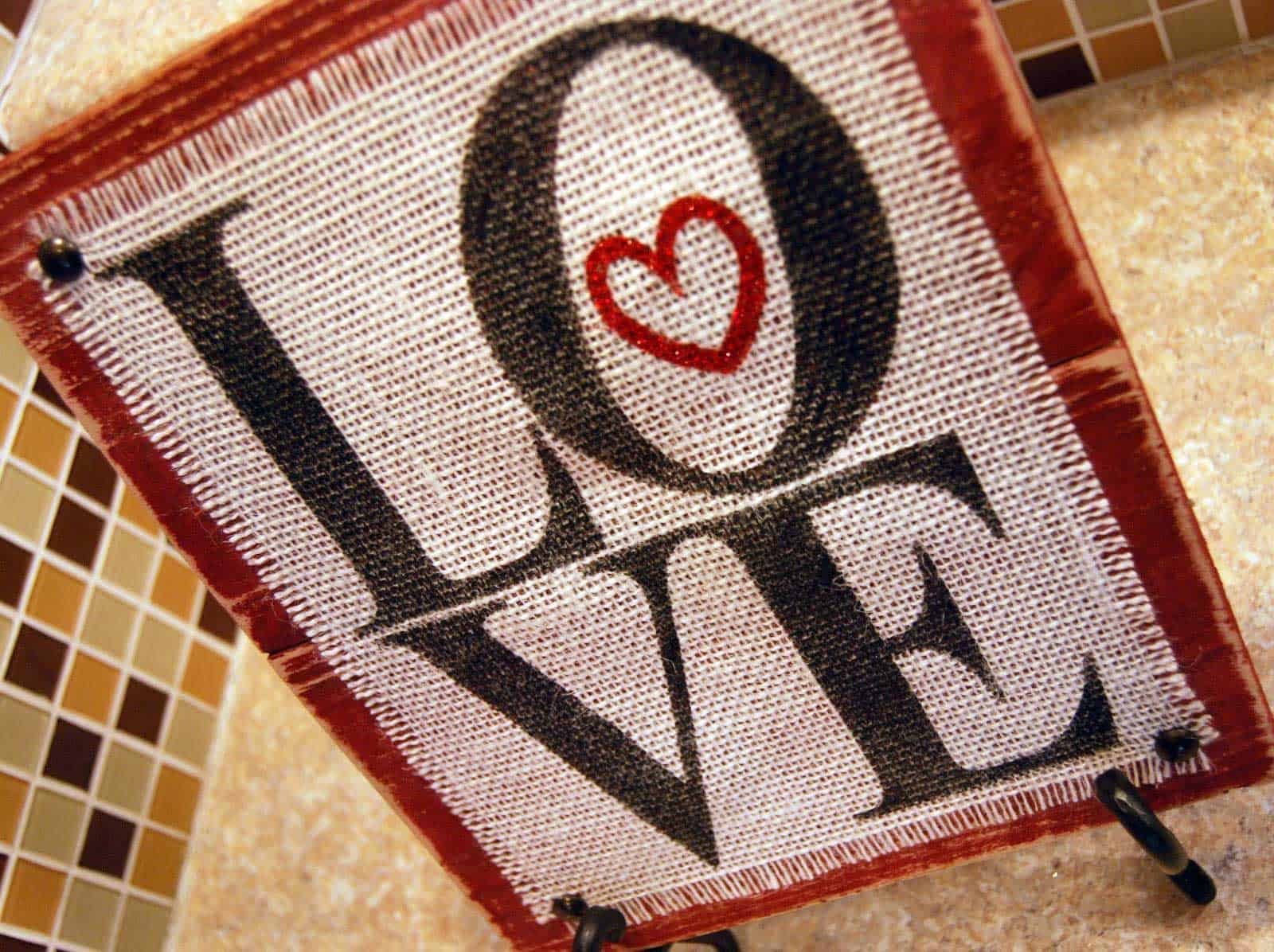Make this Burlap and Wood Love Sign with your Silhouette or Cricut. Plus, get the SVG cut file for free!