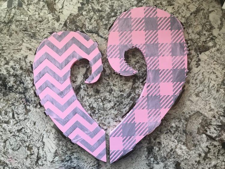 Make your own valentine door hanger with this free funky heart svg file. It works with Cricut, Silhouette, and other digital cutters