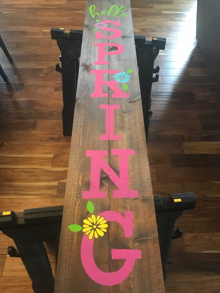 Make this cute DIY Spring Porch sign with your Cricut or Silhouette cutter. Free Hello Spring SVG file.