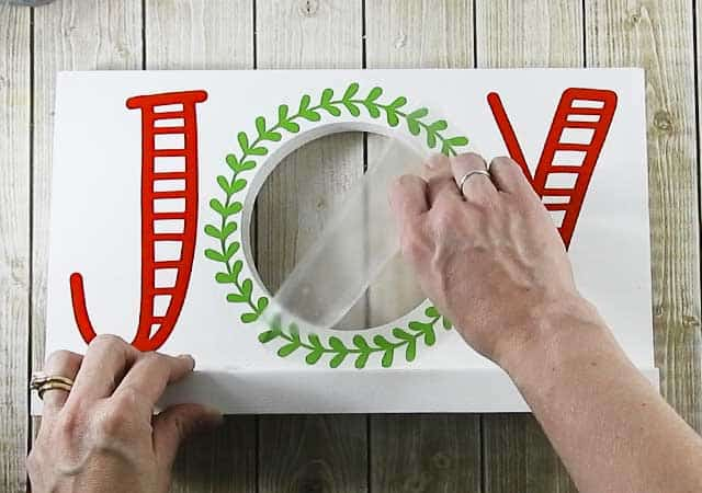 Make this cute DIY Christmas Joy Sign for you home or as a gift. #christmassvg #silhouette #cricut