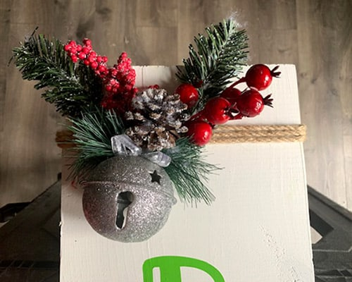Learn how to make your own Christmas Porch Sign with this easy to follow tutorial. With a few tools and your Silhouette or Cricut machine, you'll be able to create this Christmas Porch Sign for your home.. This DIY project is easy and quick to make and is the perfect decoration for you Christmas porch. #ChristmasSilhouette #ChristmasCricut #ChristmasSVG