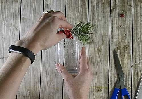 Make this cute pretty etched holiday candle holer with this easy to follow tutorial. With a few supplies and your Silhouette or Cricut machine, you'll be able to create this etched holiday candle for your home. This DIY project is easy and quick to make and is the perfect decoration for home. #ChristmasSilhouette #ChristmasCricut #ChristmasSVG