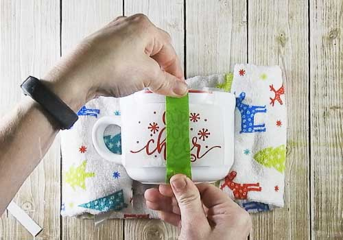 These hot chocolate gift mugs are the perfect Christmas gift for neighbors, teachers, family and friends. With a few tools and your Silhouette or Cricut machine, you'll be able to create these darling gift mugs. This DIY project is easy and quick to make and is the perfect gift for Christmas. #ChristmasSilhouette #ChristmasCricut #ChristmasSVG
