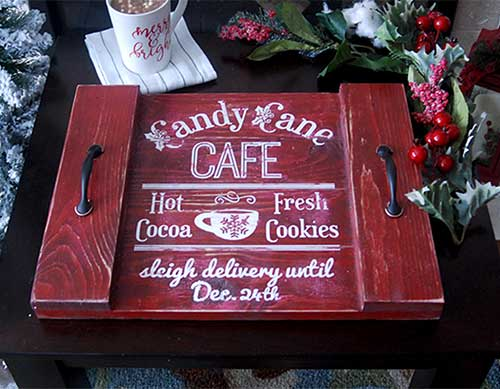 Make this cute DIY Wood Tray for Christmas sign with this easy to follow tutorial. With a few tools and your Silhouette or Cricut machine, you'll be able to create this DIY Wood Christmas Tray for your home. This DIY project is easy and quick to make and is the perfect decoration for home. #ChristmasSilhouette #ChristmasCricut #ChristmasSVG