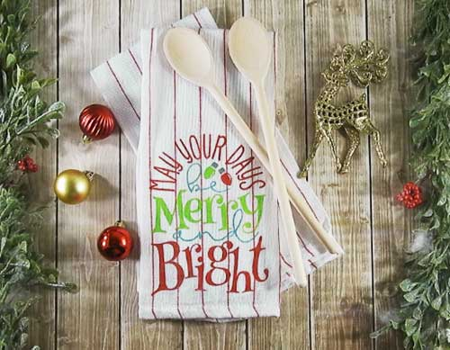Make this cute Stenciled Dish Towel for Christmas with this easy to follow tutorial. With a few supplies and your Silhouette or Cricut machine, you'll be able to create this Stenciled Christmas Dish Towel for your home or as a gift. This DIY project is easy and quick to make and is the perfect decoration for home. #ChristmasSilhouette #ChristmasCricut #ChristmasSVG