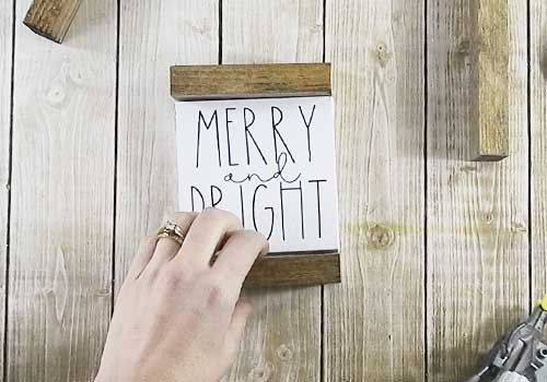 Make these adorable mini signs for Christmas sign with this easy to follow tutorial. With a few supplies and your Silhouette or Cricut machine, you'll be able to create these frame canvas Christmas signs for your home. This DIY project is easy and quick to make and is the perfect decoration for home. #ChristmasSilhouette #ChristmasCricut #ChristmasSVG