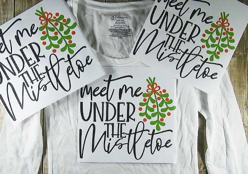 Make your own custom t-shirt for Christmas with this easy to follow tutorial. With a few tools and your Silhouette or Cricut machine, you'll be able to create this Christmas t-shirt. This DIY project is easy and quick to make and is the perfect addition to your holiday attire. #ChristmasSilhouette #ChristmasCricut #ChristmasSVG