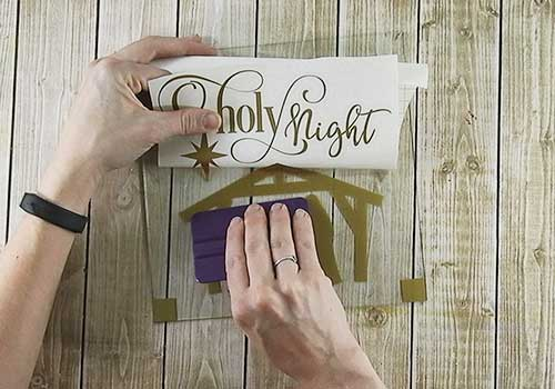 Make this Lighted Christmas shadow box sign with this easy to follow tutorial. With a few supplies and your Silhouette or Cricut machine, you'll be able to create this Lighted Christmas Shadow Box for your home home. This DIY project is easy and quick to make and is the perfect decoration for home. #ChristmasSilhouette #ChristmasCricut #ChristmasSVG