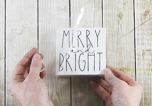Make these adorable adorable mini signs for Christmas sign with this easy to follow tutorial. With a few supplies and your Silhouette or Cricut machine, you'll be able to create these frame canvas Christmas signs for your home. This DIY project is easy and quick to make and is the perfect decoration for home. #ChristmasSilhouette #ChristmasCricut #ChristmasSVG