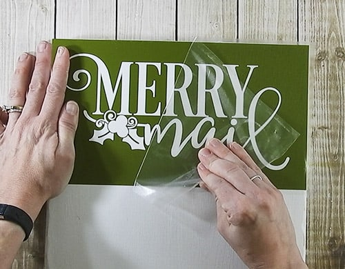 Create a place to display your Christmas Cards with this easy to follow tutorial. With a few supplies and you Silhouette or Cricut machine, you be able to create this cut Christmas Card holder for your home. This DIY project is easy and quick to make and is the perfect decoration for home. #ChristmasSilhouette #ChristmasCricut #ChristmasSVG #ChristmasCardholder