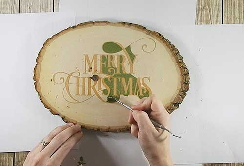 Make your own custom Christmas wood slice with your Silhouette or Cricut machine. This DIY project is easy and quick to make and is the perfect decoration for home. #ChristmasSilhouette #ChristmasCricut #ChristmasSVG #Christmaswoodslice